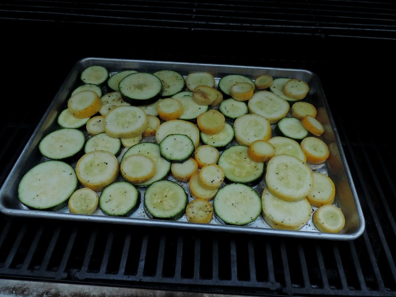 Slice up green & yellow summer squash, toss in olive oil, salt & pepper.  Layer on baking pan with a little butter.