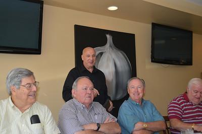 Rick Burkholder talks about the menu with Nick Hughes, Walter Shelton, Jeff Weekley, Leonard Kowaleski