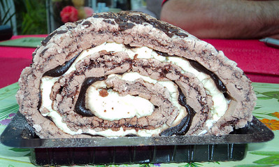 Chocolate Meringue Roulade - baked with dark chocolate flakes and rolled with Belgian Chocolate sauce and whipped cream. From Marks & Spencers