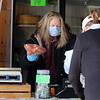 Caroline Zuk of Dracut has opened the farmstand at Saja Farm early in the season, with produce brought from Boston, to help local residents during the Covid-19 emergency. Zuk, left, rings up purchase by Peg Biedron of Dracut. (SUN/Julia Malakie)