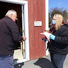 Farm manager John Grzesik of Dracut, and owner Caroline Zuk of Dracut, who's opened the farmstand at Saja Farm early in the season, with produce brought from Boston, to help local residents during the Covid-19 emergency. (SUN/Julia Malakie)