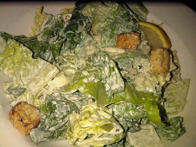 """Caesar Salad - Crisp romaine and aged Parmesan cheese in creamy dressing. C$6.95.  Served in """"The Keg"""" in London  31/01/13"""