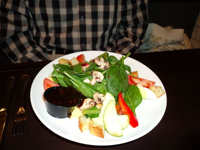 """Spinach Salad - fresh spinach, mushrooms, peppers, bacon bits, tomatoes, egg and croutons. C$8.49.  Served in """"Mcginnis Landing"""" in London, Ontario  04/02/11"""