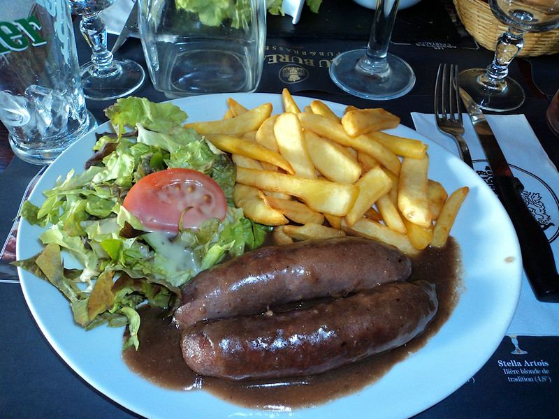 "Toulouse Sausages - Chips, gravy sauce & salad. €15.20. <br /> Served in ""Au Bureau""<br /> <br /> 07/06/14"