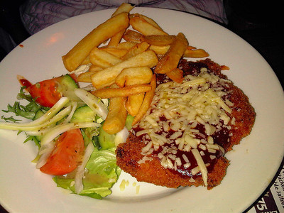 "Taxan Pork Escalope - Breaded pork escalope topped with BBQ sauce and melted amture Cheddar, served with chips and a dressed salad. £8.75. Served in ""The Flagship"" in Paignton  16/02/12"