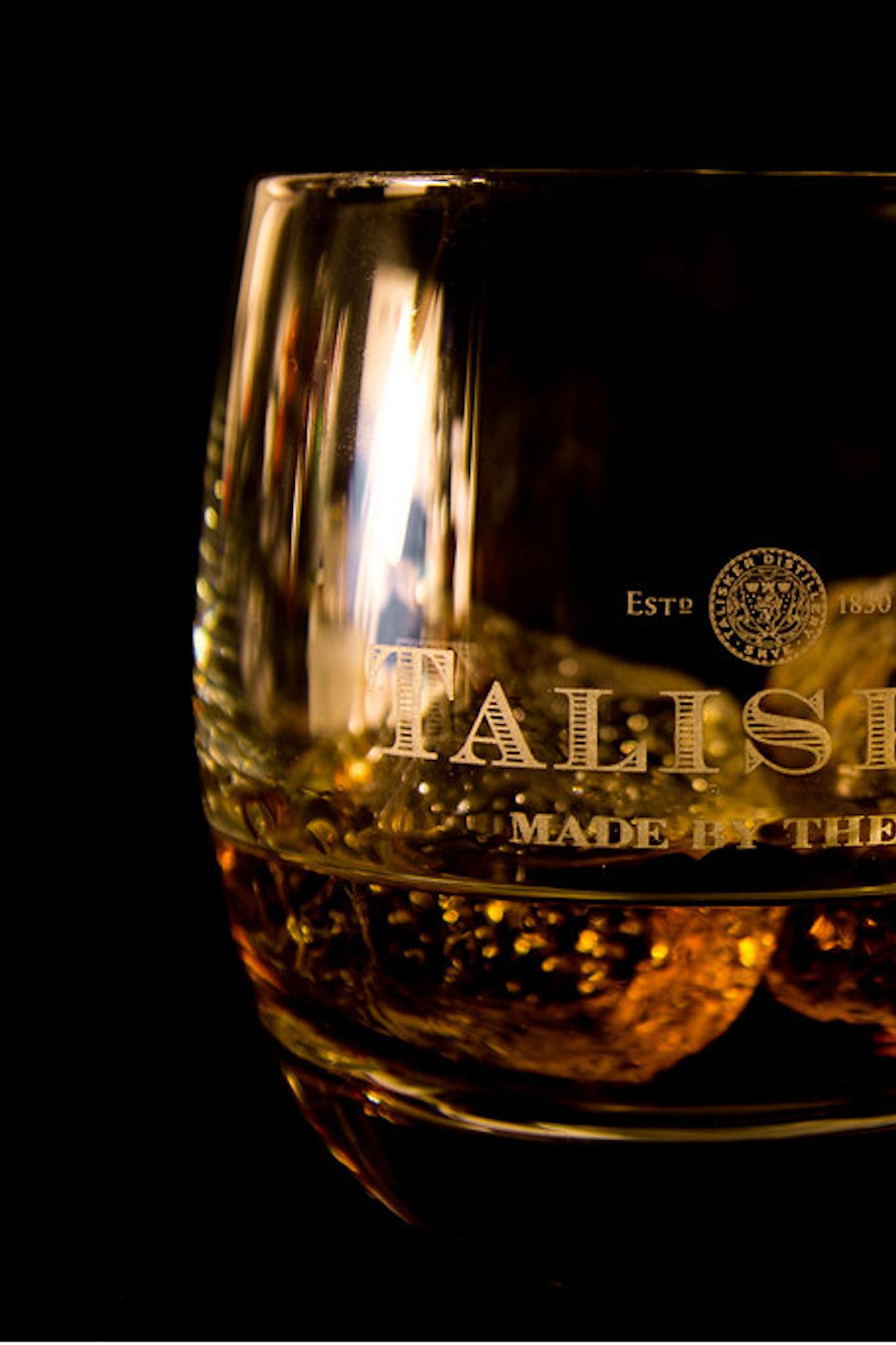 Scottish whisky on a black backdrop.