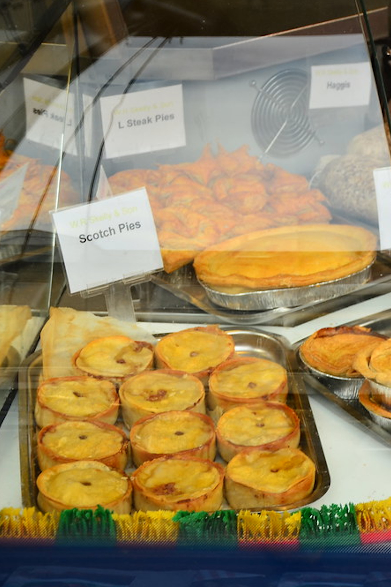 Scottish pies in a store featuring Scottish foods.