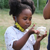 Nailantei Lemunke, 4, of Haverhill, eats cookie dough ice cream at Shaw's Ice Cream in Dracut. (SUN/Julia Malakie)