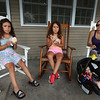 Clockwise from left, twins Emma and Marina Giuffre, 8, and their babysitter Rachael Spanos, with her son Jonathan Spanos, 10 months old, all of Pelham, N.H., at Shaw's Ice Cream in Dracut. Emma got fluffernutter ice cream, and Marina got fudgy vanilla. (SUN/Julia Malakie)