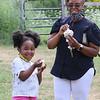 Pitty Wamae and her granddaughter Nailantei Lemunke, 4, both of Haverhill, at Shaw's Ice Cream in Dracut. Wamae got butter pecan, and Lemunke got cookie dough ice cream. (SUN/Julia Malakie)
