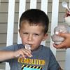 Cameron Arcand, 4, of Dracut, eats Oreo ice cream at Shaw's Ice Cream in Dracut. (SUN/Julia Malakie)