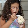Emma Giuffre, 8, of Pelham, N.H., eats fluffernutter ice cream at Shaw's Ice Cream in Dracut. (SUN/Julia Malakie)