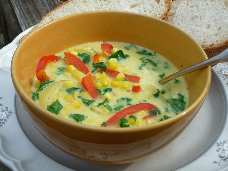 """<h1>Thai Coconut Corn Soup</h1> I must admit it was the PICTURE of this soup in Nava Atlas' <i><a href=""""http://www.amazon.com/Vegan-Express-Nava-Atlas/dp/076792617X/ref=ntt_at_ep_dpi_4"""">Vegan Express</a></i> cookbook that got me to make this for the first time.  The NAME of the soup never would have.   I never thought I liked coconut.   But rather, what I'm finding is that I don't like <b><i>the grated stuff</i></b> that gets put on cakes and cookies and such.  But I'm trying more and more recipes that use coconut MILK, and I'm finding I like that just fine.   My first recipe that I tried that used coconut milk was something I figured would be a sure winner:  <a href=""""http://www.flickr.com/photos/nc_hiker/3866189016"""">homemade ice cream</a>, and I couldn't even pick up the coconut flavor there.  So I got brave and tried this soup and all I can say is YUMMMMMM!!!!  As with all the recipes in this cookbook, the soup is very quick to fix (15 minutes or so).  It is quite low fat, since the recipe calls for Light Coconut Milk, which only has 4 grams of fat per can.  I didn't even use the tablespoon of olive oil that the recipe called for sauteing the veggies in; rather I sauteed them in a bit of broth instead.   Serve with crusty bread or for gluten free folks, a <b><a href=""""http://www.brendajwiley.com/chickpea_flatbread.html""""></b>gluten free flat bread</a>, and you've got a fabulous lunch or light supper!!  Recipe <b><a href=""""http://www.vegan.com/recipes/vegancom-top-10-recipes-of-2008/nearly-instant-thai-coconut-corn-soup-vegancom-top-10-recipe-2008/"""">here</a></b>."""