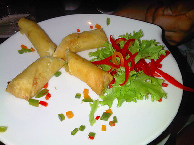 """Himalayan Yak Roll - Cheese, spring onion, garlic, coriander, served with drizzle of Nepalese special herbs and spices. £3.95. Served in """"Gurkha Restaurant"""" in Dawlish  19/07/12"""