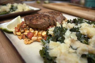steak over corn salad with colcannon