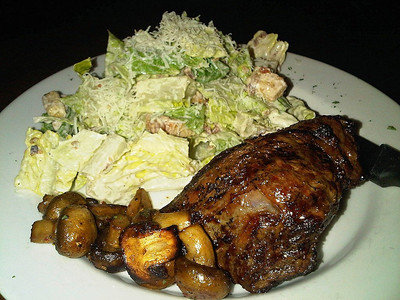 """Fire Grilled Ribeye - A 10oz. AAA ribeye topped with sauteed mushrooms. Served with a tossed or Caesar salad. C$18.99  Served in the """"Waltzing Weasel"""" in London, Ontario  05/02/14"""