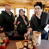"Eric Carpenter, left, and Tiffany Cooper, and Eve Orenstein, sample some of the items that will traded at the Stonebridge Farm food swap.<br /> For a video of the food swap, go to  <a href=""http://www.dailycamera.com"">http://www.dailycamera.com</a>.<br /> Cliff Grassmick / April 18, 2012"