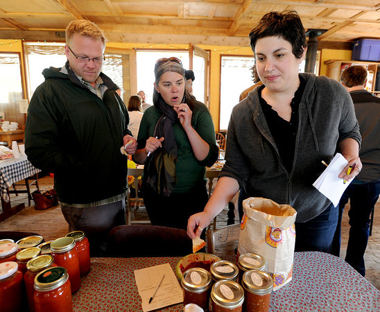 """Eric Carpenter, left, and Tiffany Cooper, and Eve Orenstein, sample some of the items that will traded at the Stonebridge Farm food swap.<br /> For a video of the food swap, go to  <a href=""""http://www.dailycamera.com"""">http://www.dailycamera.com</a>.<br /> Cliff Grassmick / April 18, 2012"""