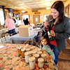 "Katie Downey and her daughter, Hazel, 3, prepare their display of food and wine to be swapped.<br /> For a video and more photos  of the food swap,  go to  <a href=""http://www.dailycamera.com"">http://www.dailycamera.com</a>.<br /> Cliff Grassmick / April 18, 2012"