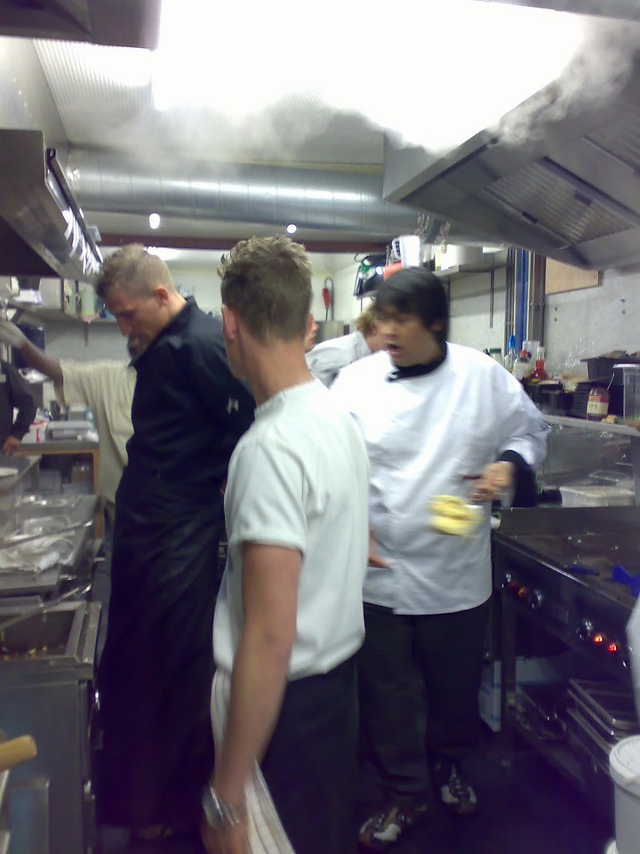 Busy hour stress in the kitchen with the diningroom filled and maxed out! Michiel (chef), Gino and Geoffrey (chef).