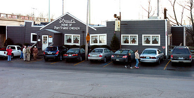"This photo was made in December 2005 at the 85th Street location of Stroud's. Note the sign now has ""Stroud's"" at the top. A large addition has been added to the west side of the building)right in this photo)."