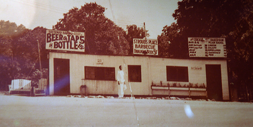Undated photo of what is most likely the first Stroud's location in Kansas City, Mo. opening in 1933. This photo shows two doors and two businesses, both apparently sharing the building. The location according to the sign is 8500 Troost.  (Photo courtesy of Stroud's Restaurant)