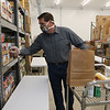 Volunteer Rick Bailey of Townsend packs bags and boxes of food for seniors and families in need, at the Townsend Ecumenical Outreach food bank.  (SUN/Julia Malakie)
