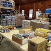 Food waiting to be sorted and shelved at the Townsend Ecumenical Outreach food bank.  (SUN/Julia Malakie)