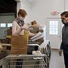 Volunteers Jeanne Urda and Rick Bailey, both of Townsend, pack bags and boxes of food for seniors and families in need, at the Townsend Ecumenical Outreach food bank.  (SUN/Julia Malakie)