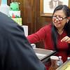 "Elonor Halsdorff, with Al Dente restaurant, serves up some strawberry shortcakes on a stick at the ""Taste of Leominster"" on Wednesday night at City Hall. SENTINEL & ENTERPRISE/JOHN LOVE"