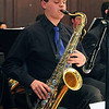 """Leominster High School senior Troy Nelson played the saxophone with the school jazz band at the """"Taste of Leominster"""" on Wednesday night at City Hall. SENTINEL & ENTERPRISE/JOHN LOVE"""