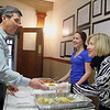 """Lindsey Szajner, 20, and Colleen Faris a mayoral aid serves up some chicken piccata to Peter McDonald at the """"Taste of Leominster"""" on Wednesday night at City Hall. SENTINEL & ENTERPRISE/JOHN LOVE"""