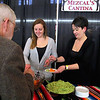 """Jessica Stanley and Michelle Charpentiel serve up some home made house guaccamole at the """"Taste of Leominster"""" on Wednesday night at City Hall. SENTINEL & ENTERPRISE/JOHN LOVE"""