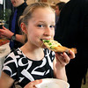 """Macy Atkinson tries some pizza from Clockworks at the """"Taste of Leominster"""" on Wednesday night at City Hall. SENTINEL & ENTERPRISE/JOHN LOVE"""