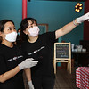 Opening of Tasty Dumplings, new restaurant on Market Street at Cardinal O'Connell Parkway. Tasty Dumplings owner Michelle Wang of Billerica, right, with her friend Meili Jin of Concord, who was using a remote to get the menu up on a big screen. (SUN/Julia Malakie)