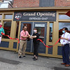 Opening of Tasty Dumplings, new restaurant on Market Street at Cardinal O'Connell Parkway. Doing a socially distanced ribbon-cutting, from left, City of Lowell community development assistant Betty Rawnsley-Erazu, city councilor Sokhary Chau, Tasty Dumplings owner Michelle Wang of Billerica, Paul Ratha Yem, and Gigi Desmond, from City of Lowell Planning & Development. (SUN/Julia Malakie)