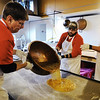 Tom Hamsher (left), owner of Minerva Candy Co. in Webb City, and Dave Armstrong (center) of Webb City pour out a batch for candy canes Saturday afternoon, Nov. 23, 2013. Former Minerva owner Duke Mallos gives direction.<br /> Globe | T. Rob Brown