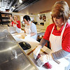Minerva Candy Co. in Webb City employees (from left) Linda Bogatay, Karen Steele and Jackie Filarski create the red and green portions for a batch of candy canes Saturday afternoon, Nov. 23, 2013.<br /> Globe | T. Rob Brown