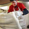 Tom Hamsher, owner of Minerva Candy Co. in Webb City, works up a batch for candy canes Saturday afternoon, Nov. 23, 2013.<br /> Globe | T. Rob Brown