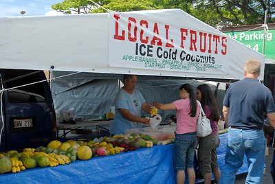 Farmer's fruit stand with lots of fresh ripe organic tropical fruits for sale.