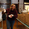 UTEC cafe assistant manager Ginny Chhuon helps pack meals for delivery to UTEC Young Adults. They are doing 56 boxes, on Mondays, Wednesdays and Fridays. (SUN/Julia Malakie)