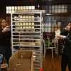 UTEC career pathways manager Sophea Sou, right, and cafe assistant manager Ginny Chhuon, left, pack meals for delivery to UTEC Young Adults. They are doing 56 boxes, on Mondays, Wednesdays and Fridays. (SUN/Julia Malakie)