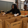 UTEC career pathways manager Sophea Sou puts eggs in cartons as she helps pack meals for delivery to UTEC Young Adults. They are doing 56 boxes, on Mondays, Wednesdays and Fridays. (SUN/Julia Malakie)