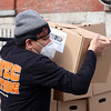 UTEC employees put together meals and weekly food boxes for distribution. Director of culinary enterprises Chris Austin of Dorchester loads weekly food boxes for delivery to the Council on Aging in Haverhill. JULIA MALAKIE/LOWELLSUN