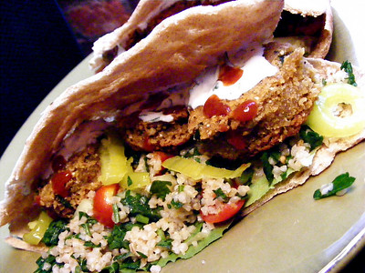 Falafel with hot sauce pepper rings and Tabbouleh
