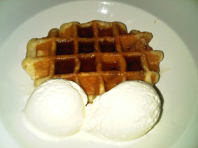 "Belgian waffle with ice cream and maple-flavour syrup.  Served in ""Wetherspoons""  06/11/13"
