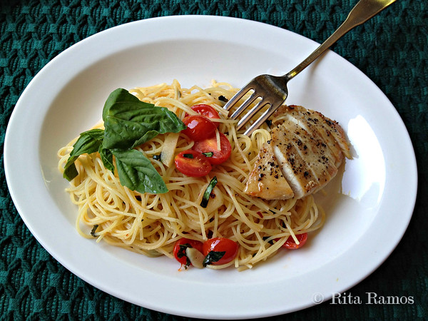 Angel hair in extra virgin olive oil with garlic slivers, fresh basil, cherry tomatoes and pan-seared chicken breast seasoned with cracked black pepper and sea salt.
