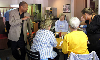 William R. Wood waves farewell to a group of women from a local Richland church while visiting Liz's Parkview Cafe in Oct. 2010. Fans of his writing in the Kalamazoo Gazette, they praised both his skill, and that of his wife, fellow journalist, Linda S. Mah. (Bradley S. Pines)