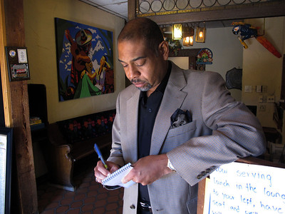 William R. Wood takes notes at Mi Ranchito in Oshtemo, Mich., while on assignment for the Kalamazoo Gazette in Oct. 2010. Note his pocket silk. Bill prided himself on his sense of style and often wrote about fashion. (Bradley S. Pines)