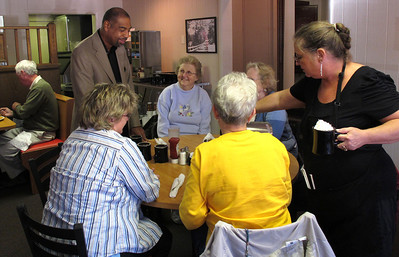 William R. Wood smiles with a group of women from a local Richland church while visiting Liz's Parkview Cafe in Oct. 2010. Fans of his writing in the Kalamazoo Gazette they praised both his skill and that of his wife, fellow journalist, Linda S. Mah. (Bradley S. Pines)